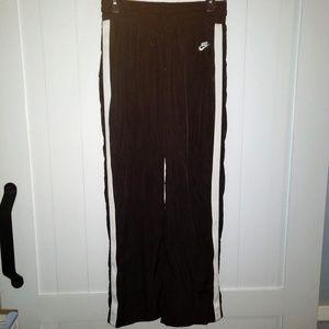 Nike womens track windbreaker pants size small